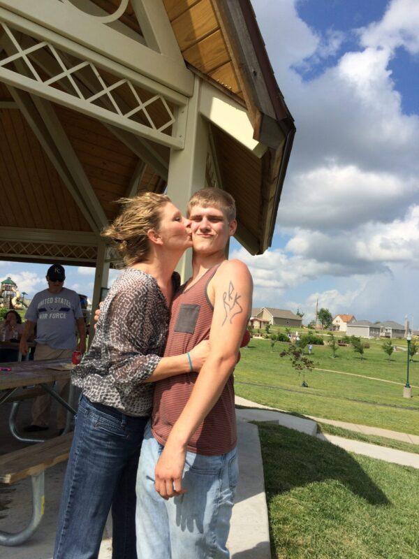 mom kissing son